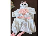 Brand new unicorn onesies with horn tail and button fastening size m