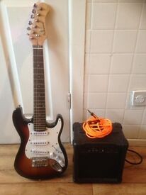 junior electric guitar with amp