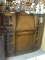 Antique cabinet, rounded glass doors and has a writing area