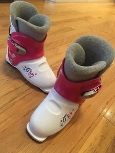 Children ski boots and skis