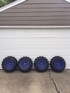 28 inch Kenda executioners on 14 inch no limit rims