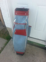 Two golf bags, clubs included and a golf bag caddy=AIRDRIE