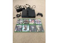 Xbox one day one edition with kinnect plus games