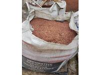 Red gravel, just under a tonne per bag