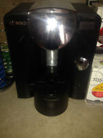Tassimo machine with rack and assorted coffees