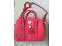 Red bag with tassles