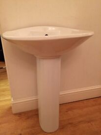 Large white basin and pedestal including chrome waste