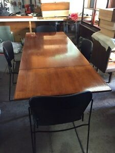 Funky! Teak wood table with black industrial chairs