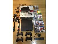 Big PlayStation 3 Bundle. 320GB, 9 Games, 4 controllers & more