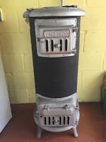 ANTIQUE STAND UP STOVE