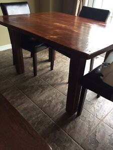 Rustic table with four chairs
