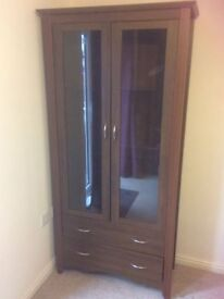 2 glass door, 2 drawer cabinet. Has 2 glass shelves. 1.90m high, 95cm wide. Very good condition.