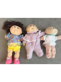 Three cabbage patch dolls