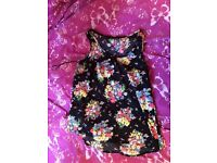 Black top with a floral design on it