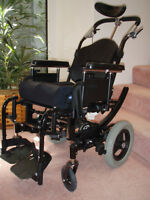 Specialized wheel chair which tilts