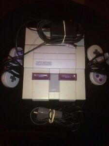 Super Nintendo system / 2 controllers / all hook ups