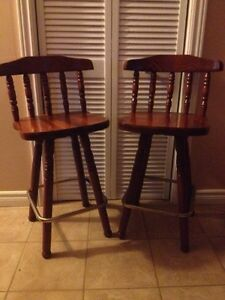 2 solid swivel bar stools