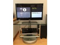 Glass swivel TV stand