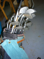 Golf clubs and cart ready to go