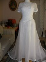 Brand New Bridal Gowns and Tucks and Top Hats
