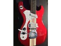 Retro boutique left handed guitar candy Apple red with racing stripes and custom tremolo
