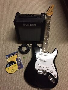 Electric guitar with amp delivered
