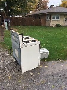 Free scrap metal.  Stove and Air Conditioner