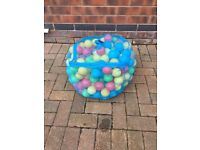 Kids play balls and small tent to suit