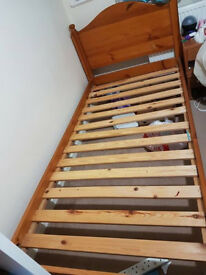 Two solid wooden single bed