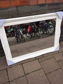 swept framed wooden mirror