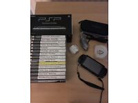 PSP Original (black) with accompanying games and accessories