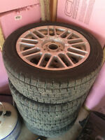 FS: 16 inch alloy wheels with winter tires 80% thread