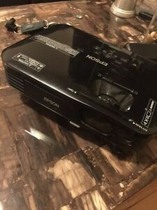 "Epson 720p HD projector and 100"" motorized screen"