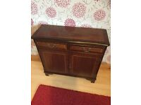 Small mahogany effect sideboard and nest of three tables