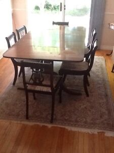 Dining table with 6 chairs and hutch with buffet cabinet.