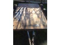 Twin wheel flat bed trailer