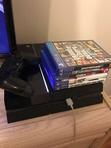 PS4 with 4 or 5 games and a controller