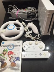 Wii system with Mario kart and wheel and controllers well kept