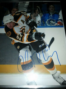 BOSTON BRUINS AUTOGRAPHED PHOTOS AND PUCKS