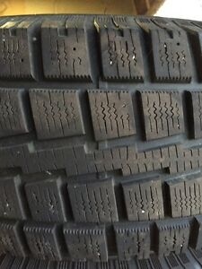 Like new snow tires with rims 265/75/R16 from Jeep Wrangler