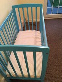 Baby's first cot and mattress for sale