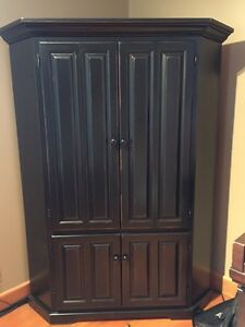 Large black wooden corner cabinet