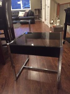 Pair of black smoked glass end tables