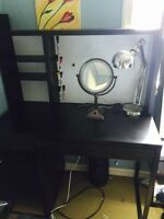 Black desk and black swivel chair