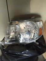 Tacoma 05 to 2011 left side headlight housing new condition