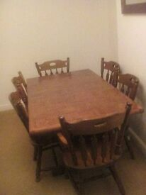 Solid Oak Dining room table with 6 chairs