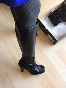 Tall fitted black boots
