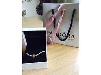 Pandora gold clasp bracelet and charms