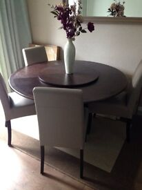 Rotating dining table with 4 chairs