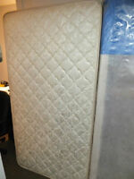 A set of NEW large twin mattress and bed foundation (non-nego)